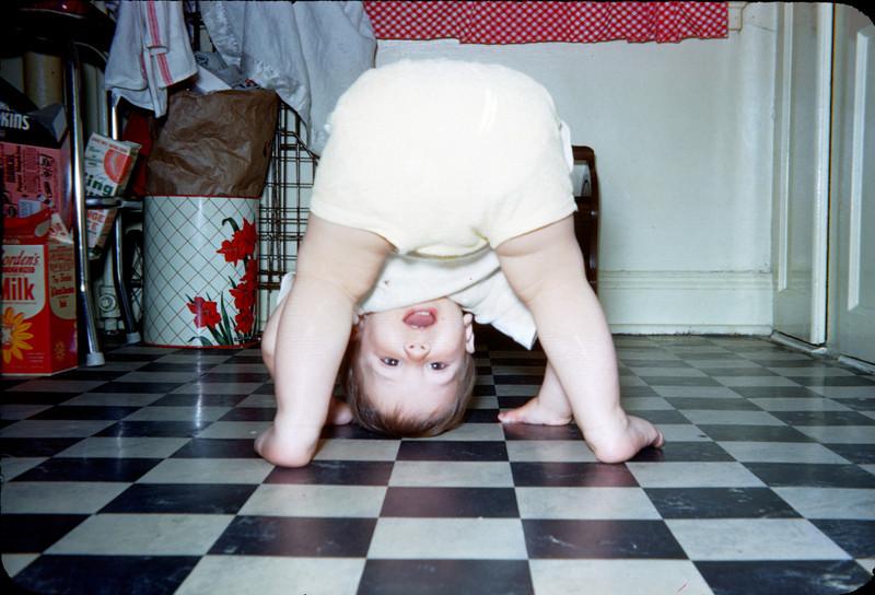 baby richard doing headstand on kitchen floor.jpg