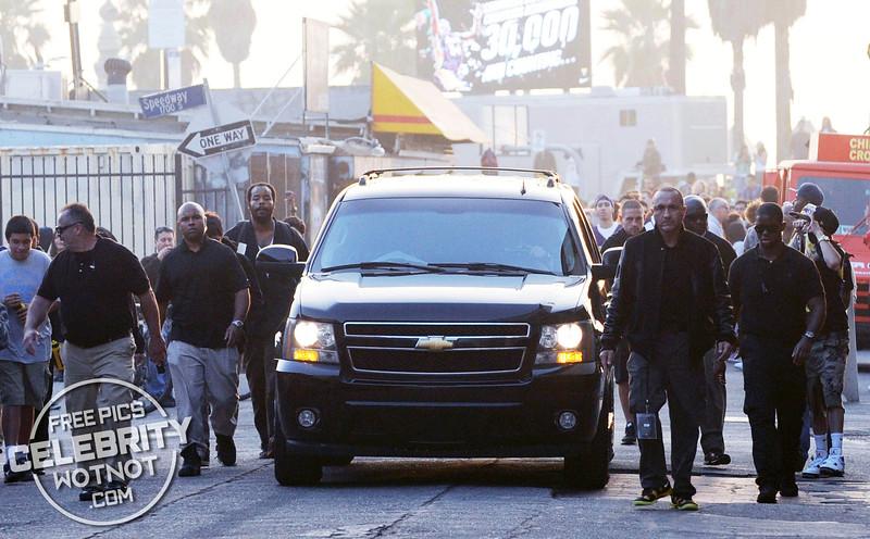 EXC: Kobe Bryant Has Five Bodyguards Running Alongside His SUV