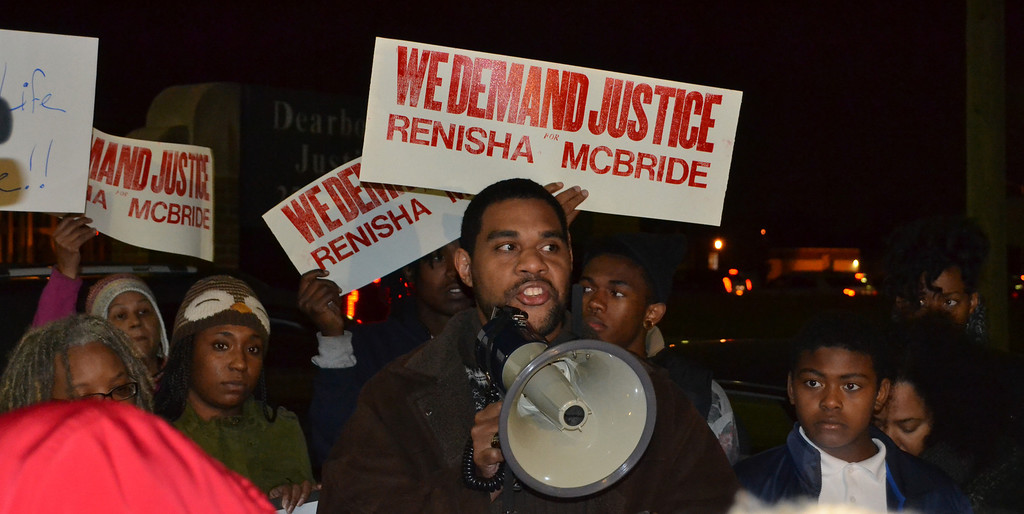 . Dawud Walid, executive director of the Council on American-Islamic Relations-Michigan Chapter, speaks in front of dozens of residents who gathered at the Dearborn Heights police station for a protest Thursday night.