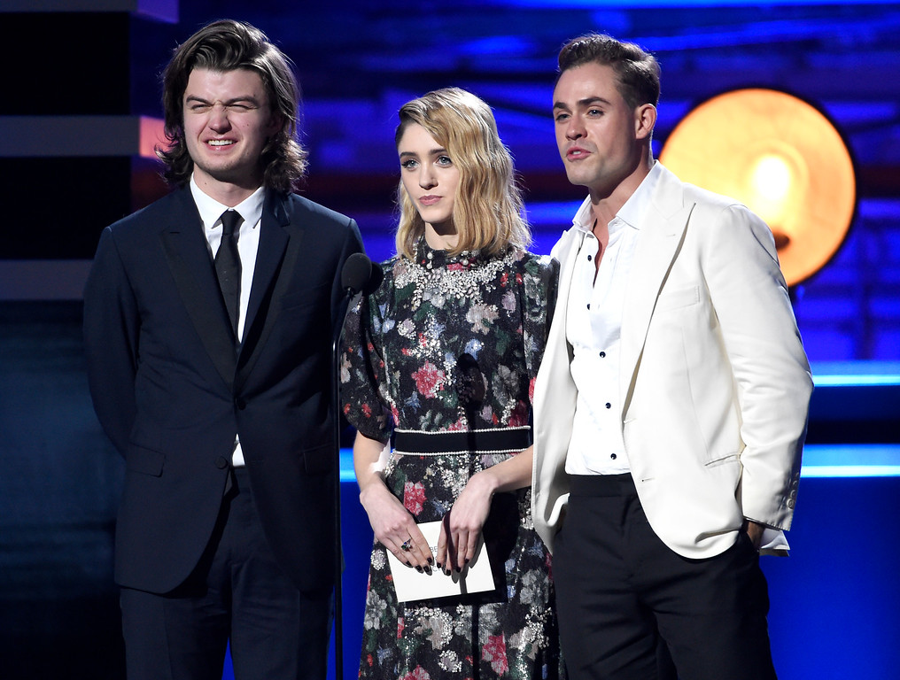 . Joe Keery, from left, Natalia Dyer, and Dacre Montgomery present the award for best supporting actress - film at the 23rd annual Critics\' Choice Awards at the Barker Hangar on Thursday, Jan. 11, 2018, in Santa Monica, Calif. (Photo by Chris Pizzello/Invision/AP)