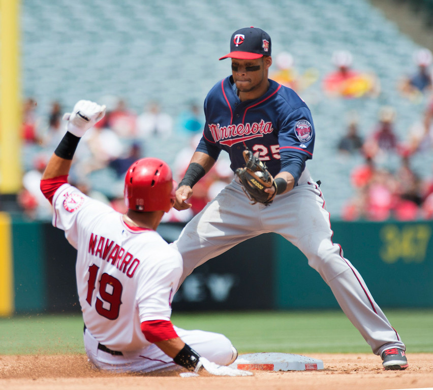 . The Minnesota Twins shortstop Pedro Florimon (#25) tags out Angels\' Efren Navarro (#19) trying to steal second base the Angels at Angel Stadium in Anaheim on Thursday June 26, 2014. (Photo by Keith Durflinger/Whittier Daily News)