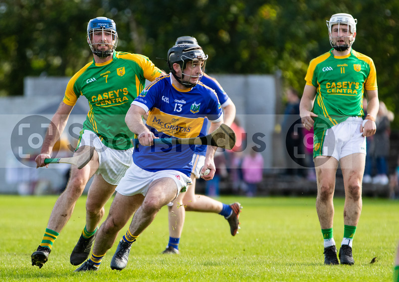 Kiladangan's Tadhg Gallagher on the attack with Toomevara's Luke Ryan and Russell Quirke in persuit in the Tipperary Senior Hurling Quarter final in Cloughjordan