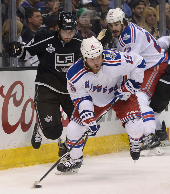. Rangers#15 Derek Dorsett skates away from Kings#26 Slava Voynov in the 2nd period. The Los Angeles Kings faced the New York Rangers in game 2 of the Stanley Cup Final.  Los Angeles, CA. 6/7/2014(Photo by John McCoy Daily News)