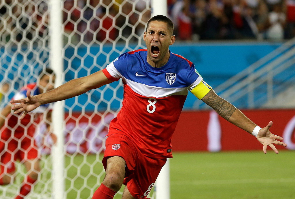 . United States\' Clint Dempsey celebrates after scoring the opening goal during the group G World Cup soccer match between Ghana and the United States at the Arena das Dunas in Natal, Brazil, Monday, June 16, 2014. The United States won the match 2-1. (AP Photo/Ricardo Mazalan)