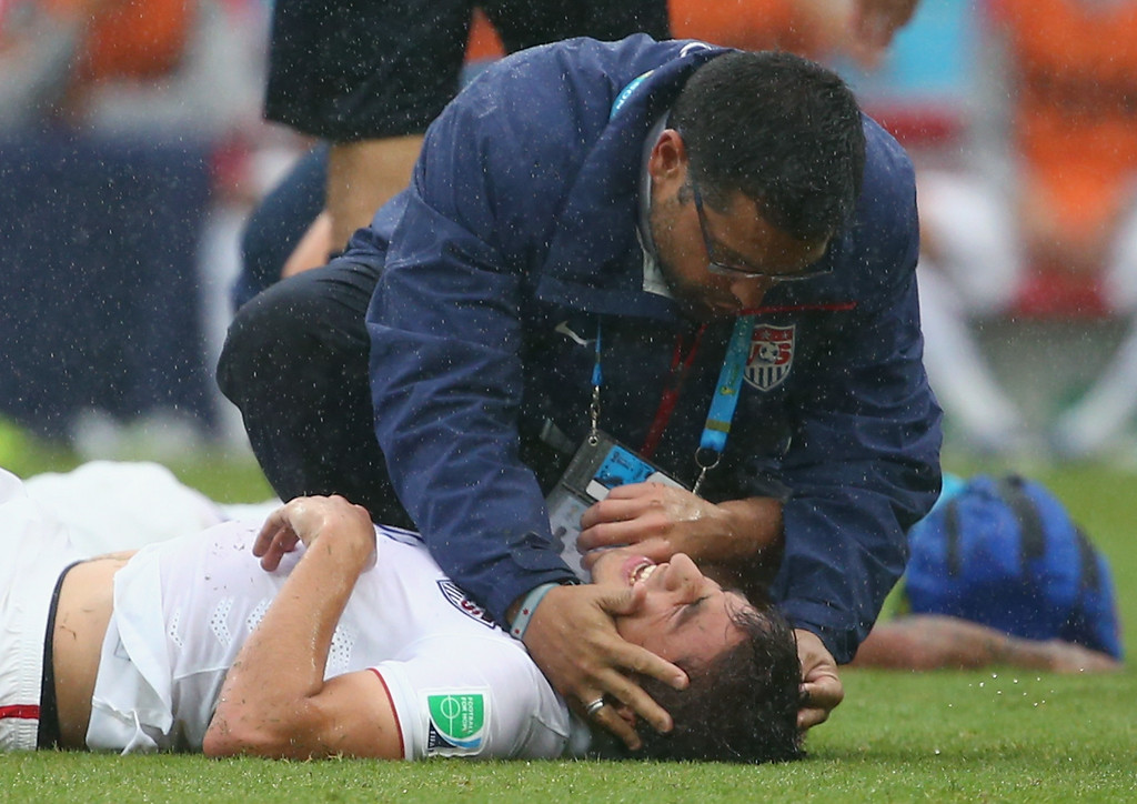 . Alejandro Bedoya of the United States receives treatment after a collision during the 2014 FIFA World Cup Brazil group G match between the United States and Germany at Arena Pernambuco on June 26, 2014 in Recife, Brazil.  (Photo by Robert Cianflone/Getty Images)