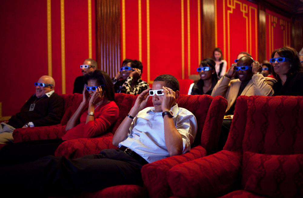 "Description of . Feb. 1, 2009 ""During a Super Bowl watching party in the White House theatre, the President and First Lady join their guests in watching one of the TV commercials in 3D."" (Official White House photo by Pete Souza)"