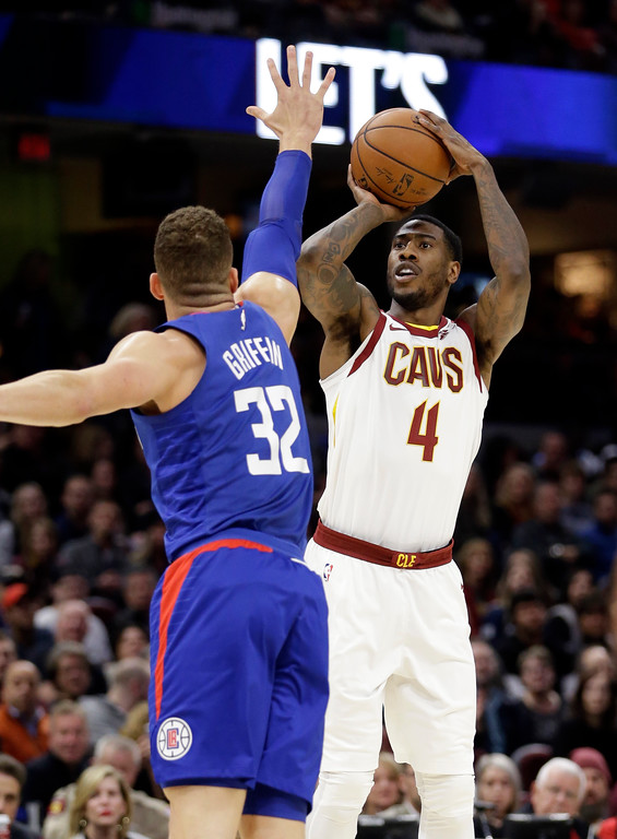 . Cleveland Cavaliers\' Iman Shumpert (4) shoots over Los Angeles Clippers\' Blake Griffin (32) in the first half of an NBA basketball game, Friday, Nov. 17, 2017, in Cleveland. (AP Photo/Tony Dejak)