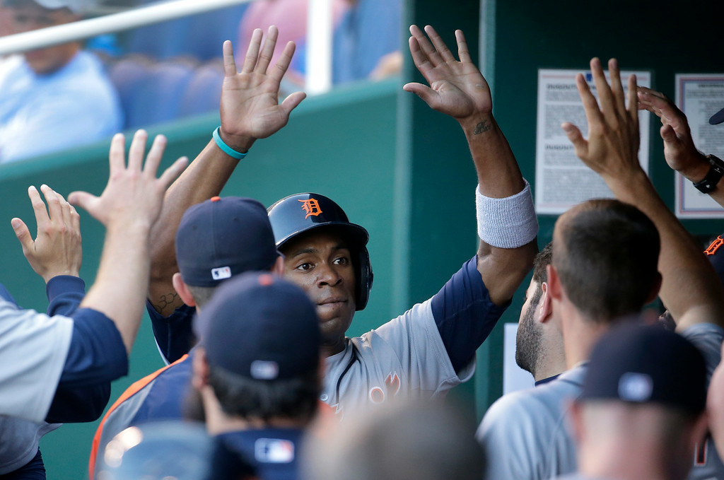 . Detroit Tigers\' Austin Jackson celebrates in the dugout after scoring on a ground out by Miguel Cabrera during the first inning of a baseball game against the Kansas City Royals Thursday, July 10, 2014, in Kansas City, Mo. (AP Photo/Charlie Riedel)