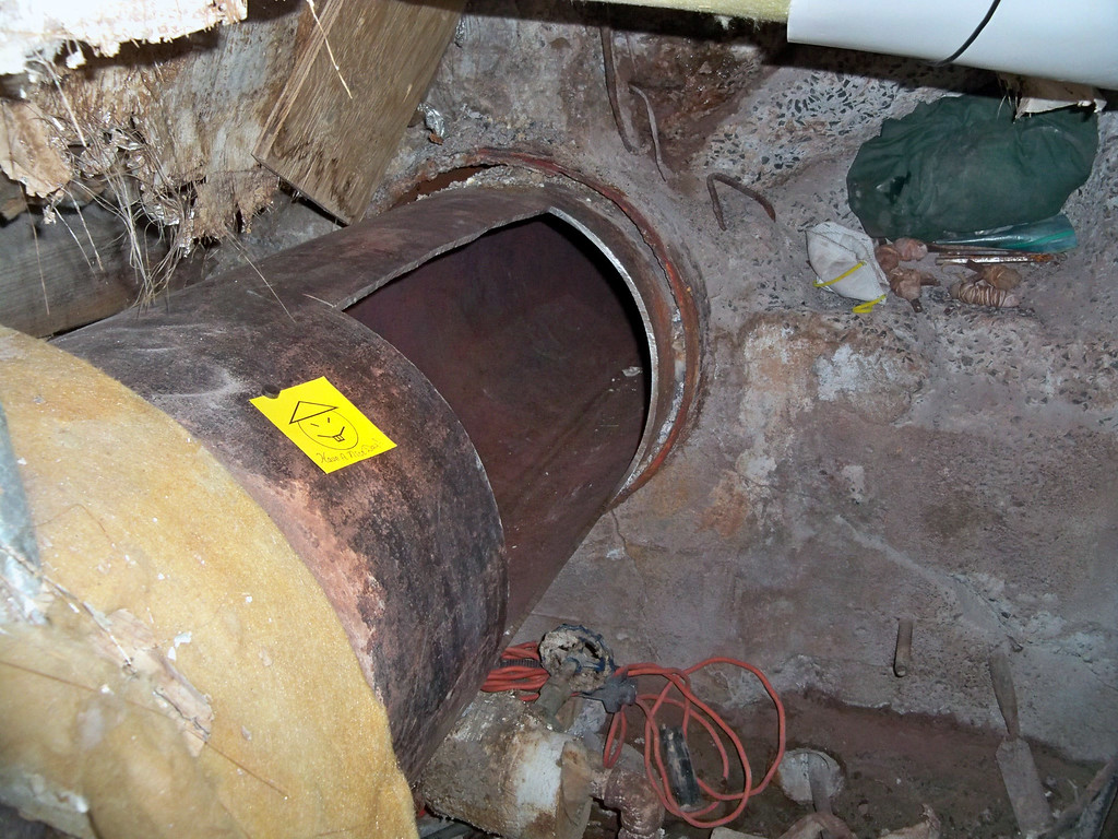 ". This photo provided by New York State Governor\'s office shows the area where two convicted murderers used power tools to cut through steel pipes, and leave a note, at a maximum-security prison in Dannemora, NY, near the Canadian border and escaped through a manhole, New York Gov. Andrew Cuomo said Saturday, June 6, 2015. He said Richard Matt, 48, and David Sweat, 34, ""are two dangerous individuals.\"" (Darren McGee/New York State Governor\'s Office, via AP)"