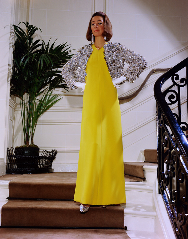 . A long bright yellow crepe evening gown by Christian Dior in 1966. (AP Photo)