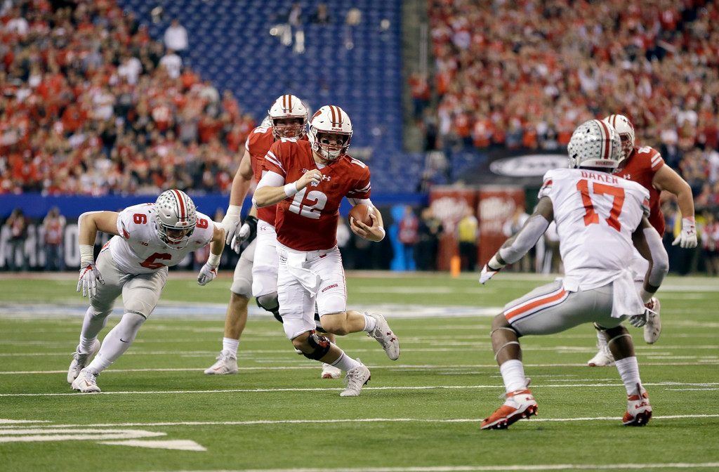 . Wisconsin quarterback Alex Hornibrook (12) runs with the ball during the first half of the Big Ten championship NCAA college football game against Ohio State, Saturday, Dec. 2, 2017, in Indianapolis. (AP Photo/AJ Mast)