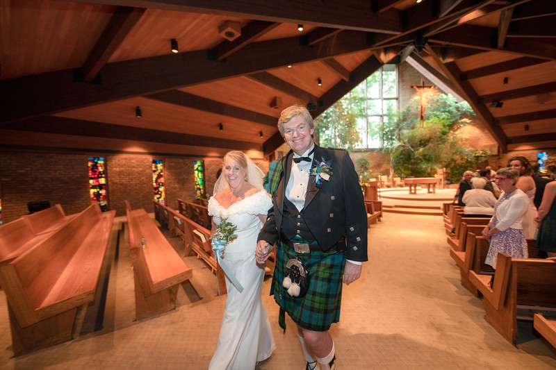Bride and Groom walking to Virgin Mary.jpg