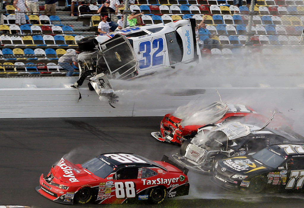 . Kyle Larson (32) goes airborne and into the catch fence in a multi-car crash involving Dale Earnhardt Jr. (88), Parker Kilgerman (77), Justin Allgaier (31) and Brian Scott (2) during the final lap of the NASCAR Nationwide Series auto race at Daytona International Speedway, Saturday, Feb. 23, 2013, in Daytona Beach, Fla. (AP Photo/John Raoux)