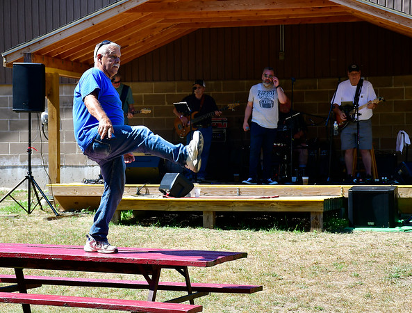 7/13/2019 Mike Orazzi | Staff Roger Saucier dances to tunes from Unfinished Business during the 29th Annual Pork & Blues Pig Roast at the Swedish Club in Bristol on Saturday.