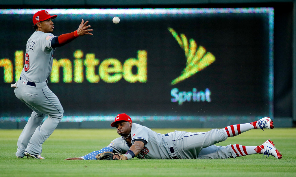 . Cleveland Indians second baseman Erik Gonzalez, left, and center fielder Rajai Davis try to field an RBI single by Kansas City Royals\' Whit Merrifield during the second inning of a baseball game Tuesday, July 3, 2018, in Kansas City, Mo. (AP Photo/Charlie Riedel)