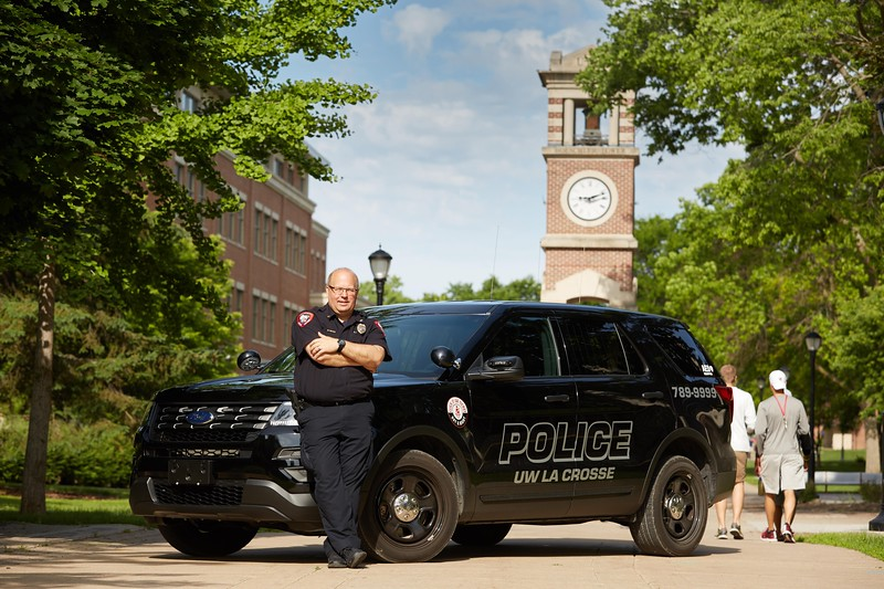Activity; Smiling; Type of Photography; Portrait; Buildings; Clock Hoeschler Tower; Location; Outside; People; Man Men; Time/Weather; day; Summer; June; UWL UW-L UW-La Crosse University of Wisconsin-La Crosse; Police Chief Scott McCullough