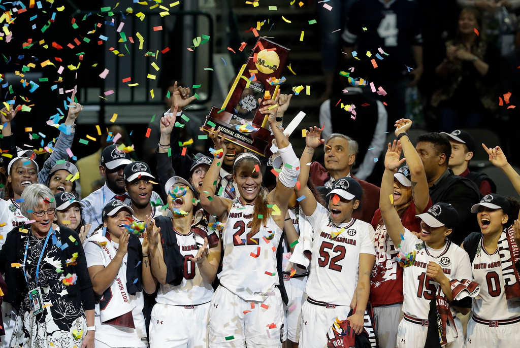 . South Carolina forward A\'ja Wilson (22) holds up the trophy as she celebrates with teammates after their win over Mississippi State in the final of the NCAA women\'s Final Four college basketball tournament, Sunday, April 2, 2017, in Dallas. South Carolina won 67-55. (AP Photo/Eric Gay)