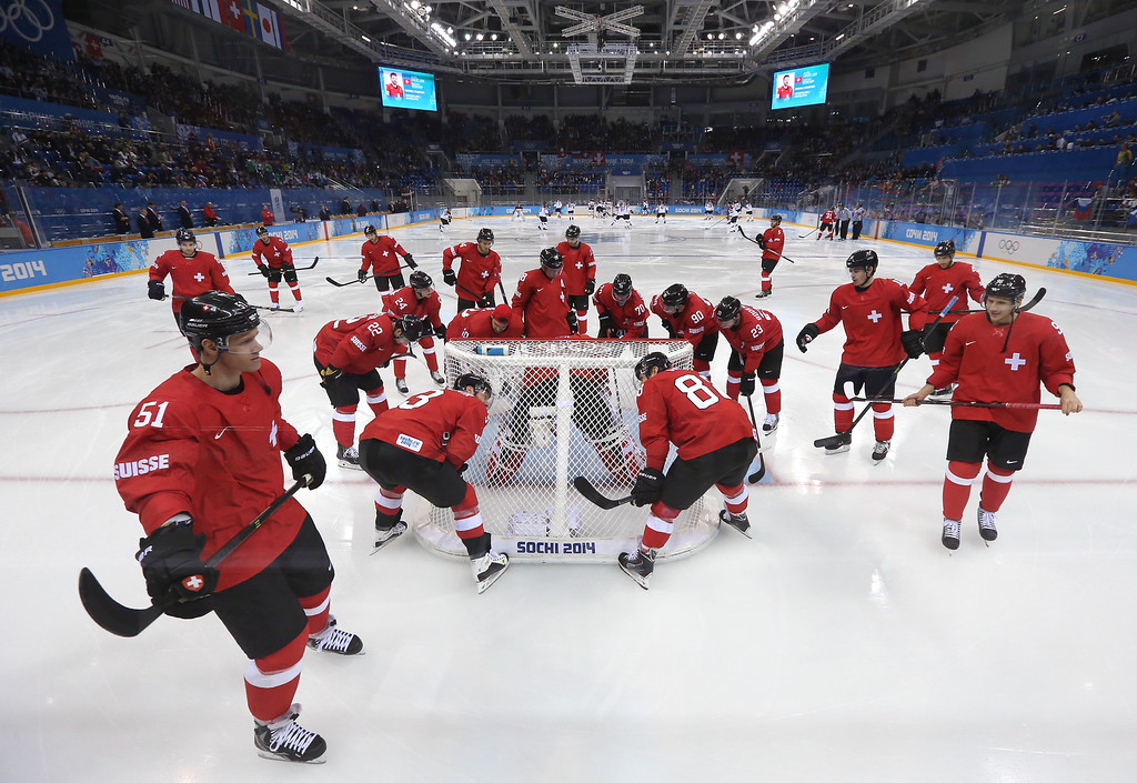 . SOCHI, RUSSIA - FEBRUARY 12: The Switzerland team gathers around the net prior to the Men\'s Ice Hockey Preliminary Round Group C game against Latvia on day five of the Sochi 2014 Winter Olympics at Shayba Arena on February 12, 2014 in Sochi, Russia.  (Photo by Martin Rose/Getty Images)