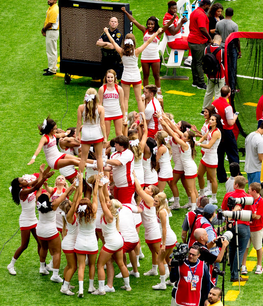 ... and then they form a great mountain of cheerleaders.
