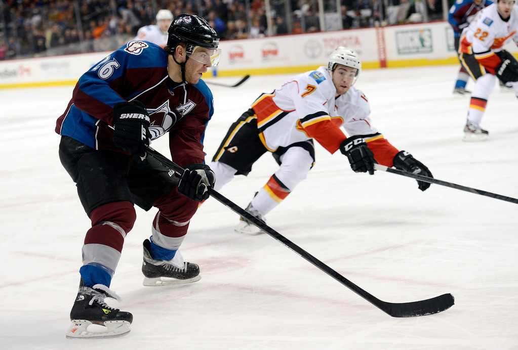 . DENVER, CO. - FEBRUARY 28: Paul Stastny (26) of the Colorado Avalanche skates the puck in to take a shot on goal as T.J. Brodie (7) of the Calgary Flames comes in on defense during the first period February 28, 2013 at Pepsi Center.(Photo By John Leyba/The Denver Post)