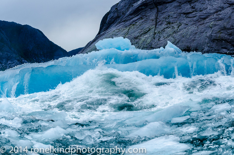 creating a violent wave, which threatened to engulf our boat...
