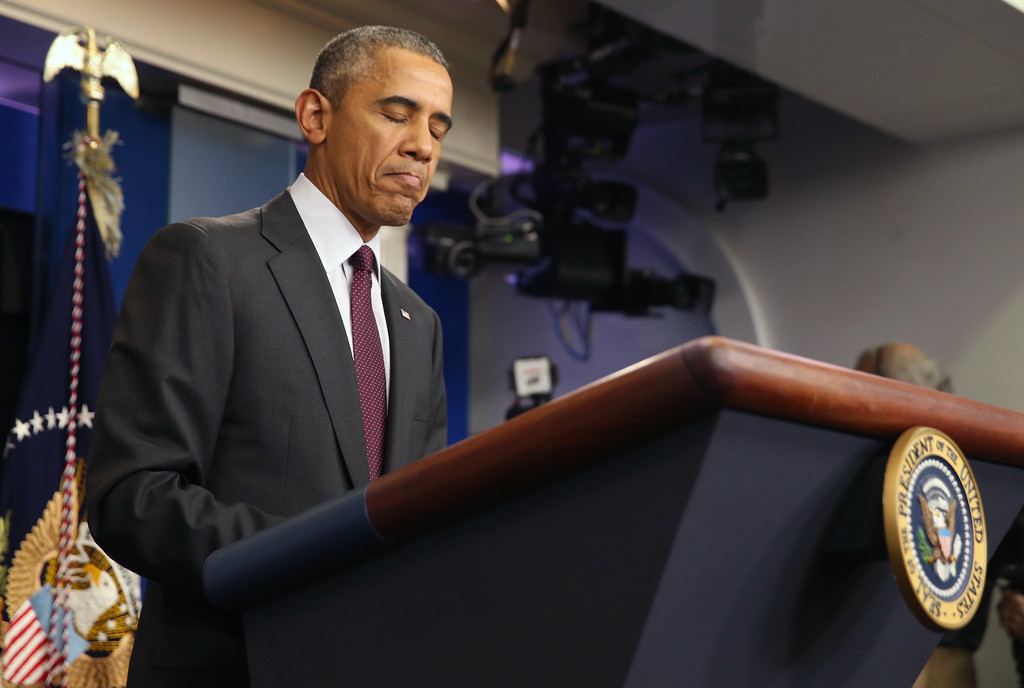 . President Barack Obama pauses as he speaks in the Brady Press Briefing Room at the White House in Washington, Thursday, Oct. 1, 2015, about the shooting at the community college in Oregon. The shooting happened at Umpqua Community College in Roseburg, Ore., about 180 miles south of Portland. (AP Photo/Andrew Harnik)