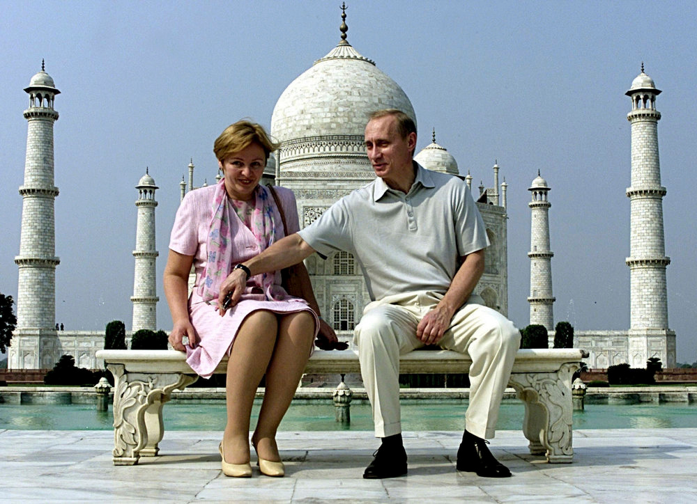 . Russian President Vladimir Putin and his wife Lyudmila sit in front of the Taj Mahal while touring the city of Agra in this October 4, 2000 photograph. Putin and his wife said on state television on Thursday that they had separated and their marriage was over after 30 years. REUTERS/Pawel Kopczynski/Files