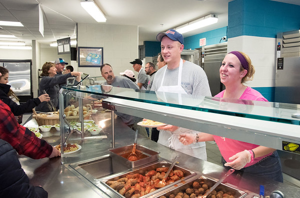 11/29/18 Wesley Bunnell | Staff A fundraiser in support of Berlin Police Ofc. Aimee Krzykowski, a 14 year veteran officer, who's is battling breast cancer was held at Berlin High School on Thursday night. Berlin Dispatcher Tom Farr, L, and Berlin High School Cafeteria Manager Heather Varricchio serve pasta dinners.