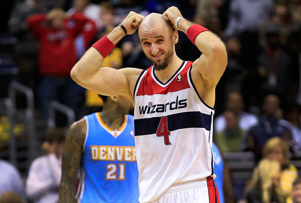 . Marcin Gortat #4 of the Washington Wizards reacts to a play during the closing minute of the Wizards 75-74 loss to the Denver Nuggets at Verizon Center on December 9, 2013 in Washington, DC.   (Photo by Rob Carr/Getty Images)
