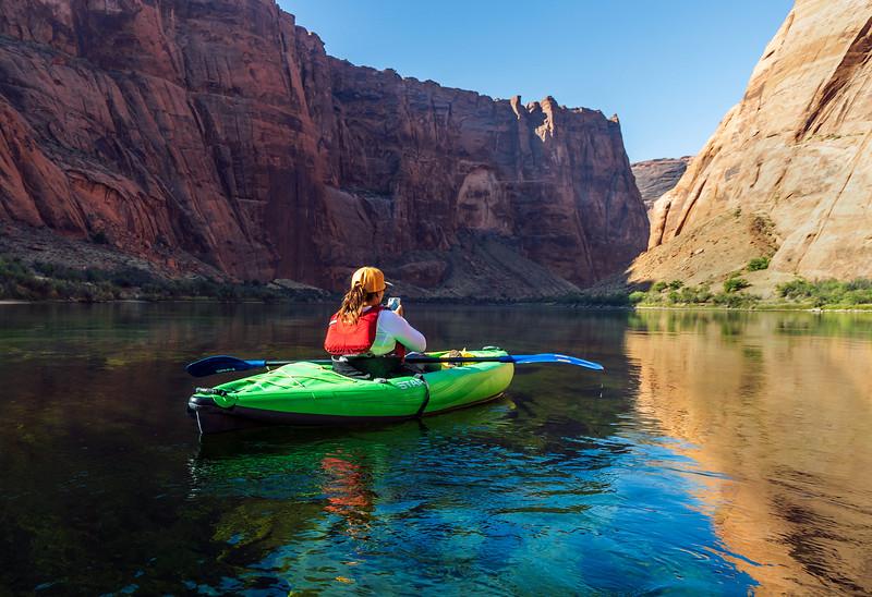 Lone Female Kayaker Heading Down Colorado River in AZ