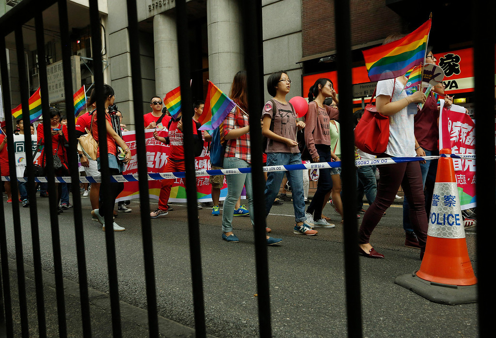 . Participants carry rainbow flags, a symbol of the gay rights movement, march at a down town street during a gay rally in Hong Kong Saturday, Nov. 9, 2013. Organizers say thousands of people are taking part in the annual Gay Pride Parade including representatives from more than 50 organizations as well as participants from the mainland and Taiwan, according to government radio. (AP Photo/Vincent Yu)