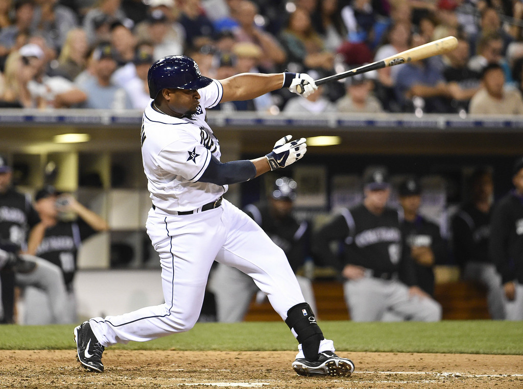 . SAN DIEGO, CA - AUGUST 12:  Chris Nelson #1 of the San Diego Padres hits a two RBI single during the eighth inning of a baseball game against the Colorado Rockies at Petco Park August, 12, 2014 in San Diego, California.  (Photo by Denis Poroy/Getty Images)