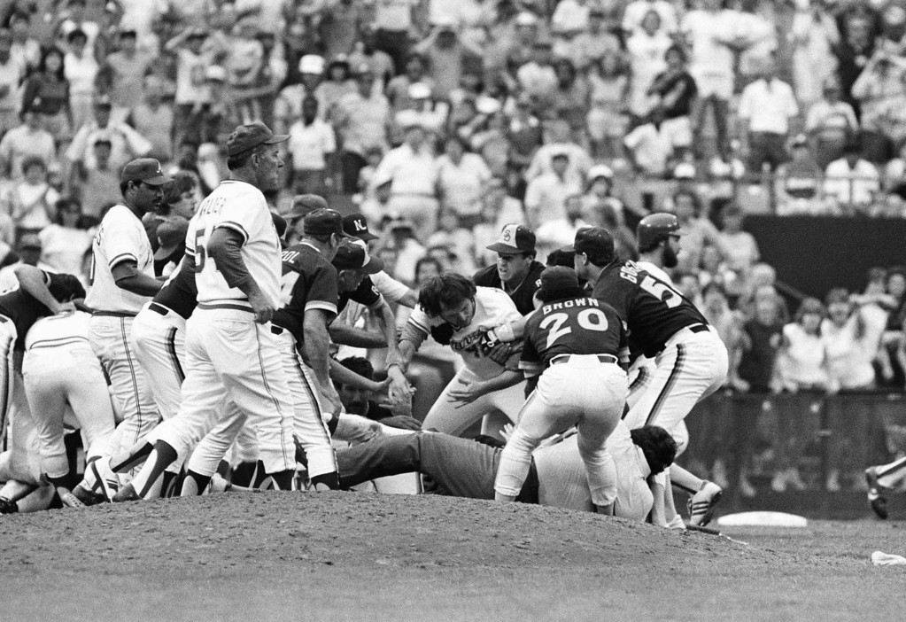 . Atlanta Braves Rick Mahler, center, is dragged away by San Diego Padres Rich Gossage, right, Bobby Brown and others August 12, 1984, during a brawl that erupted after Braves pitcher Pascual Perez was hit by a pitch from Padres pitcher Craig Lefferts at Atlanta Fulton County Stadium. (AP Photo/Charles Kelly)