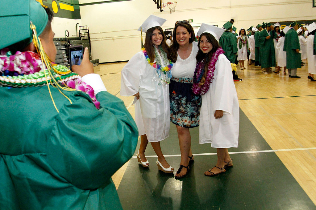 . Graduates take pictures with their Instructors, during Schurr High School 2013 Commencement Exercises, at Ken Davis Field, at Schurr High School in Montebello, Thursday, June 20, 2013. (Correspondent Photo by James Carbone/SWCITY)