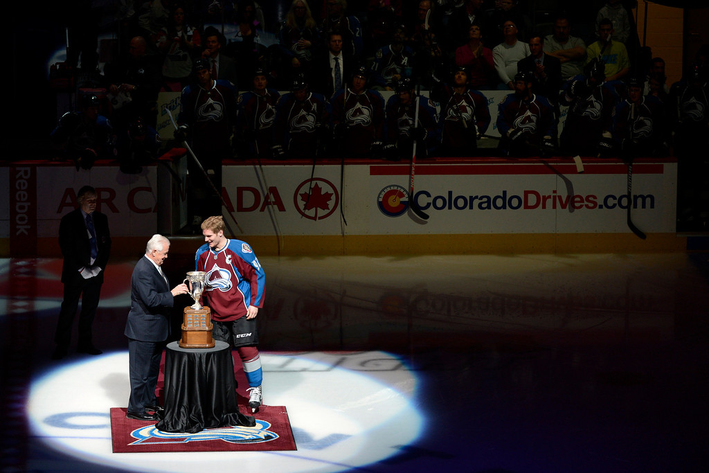 . DENVER, CO. - JANUARY 22: Colorado Avalanche left wing Gabriel Landeskog (92) accepts the Calder Memorial Trophy for NHL Rookie of the Year from retired NHL player Ralph Backstrom before the first period. The Colorado Avalanche hosted the Los Angeles Kings at the Pepsi Center on January, 22, 2013.    (Photo By John Leyba / The Denver Post)