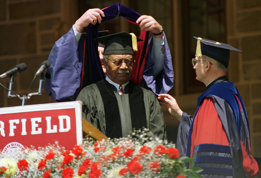 . Dr. Robert E. Wall, left,  academic vice president of Fairfield University, confers an honorary Doctor of Laws degree to Lawrence E. Doby, center, the first black baseball player to compete in the American League, Sunday, May 18, 1997 during Fairfield University\'s 47th commencement exercises in Fairfield, Conn. Reverend Alyoysius P. Kelley, president of the university, looks on at right. (AP Photo/Douglas Healey).