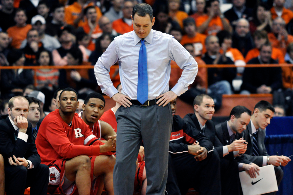 . Rutgers head coach Mike Rice reacts after Syracuse scored late in the second half of an NCAA college basketball game in Syracuse, N.Y. on Jan. 2, 2013. Rutgers has fired Rice after a videotape aired showing him shoving, grabbing and throwing balls at players in practice and using gay slurs during practice. With mounting criticism on a state and national level, the school decided to take action on Wednesday, April 3, 2013. relieving Rice of his duties after three largely unsuccessful seasons at the Big East school. (AP Photo/Kevin Rivoli, File)