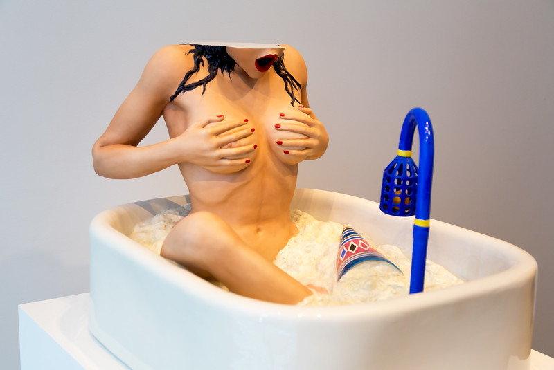 "Jeff Koon's capricious 1988 sculpture, ""Woman in a Tub."""