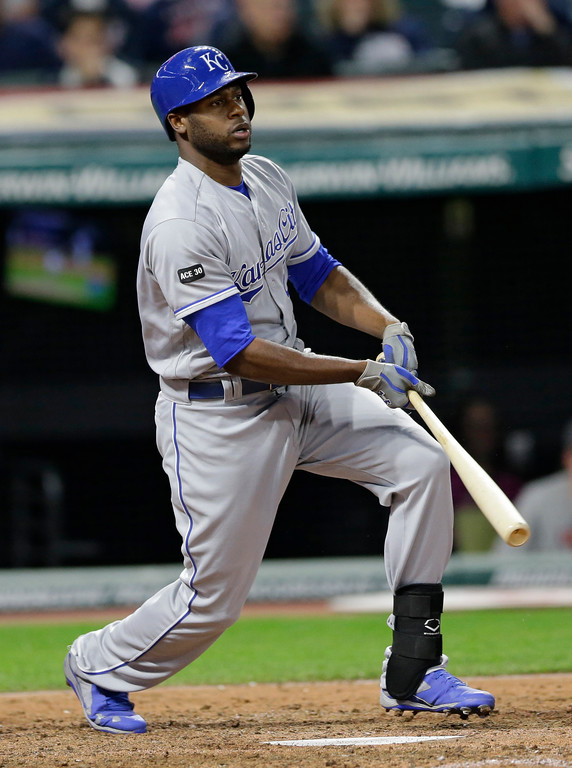 . Kansas City Royals\' Lorenzo Cain hits a single off Cleveland Indians relief pitcher Bryan Shaw in the eighth inning of a baseball game, Friday, May 26, 2017, in Cleveland. (AP Photo/Tony Dejak)