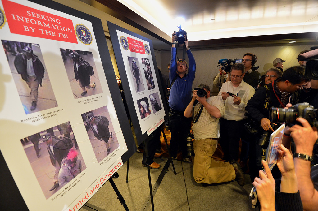 . Photographs of two suspects wanted in the Boston Marathon bombings released by the FBI are shown at a press conference April 18, 2013 in Boston, Massachusetts.  AFP PHOTO/Stan  HONDA/AFP/Getty Images