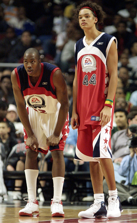 . CHICAGO, UNITED STATES:  Dwight Howard (L) and Joakim Noah (R) stand on the court 24 March, 2004 during the EA Sports Roundball Classic at the United Center, in Chicago, IL.     (JEFF HAYNES/AFP/Getty Images)