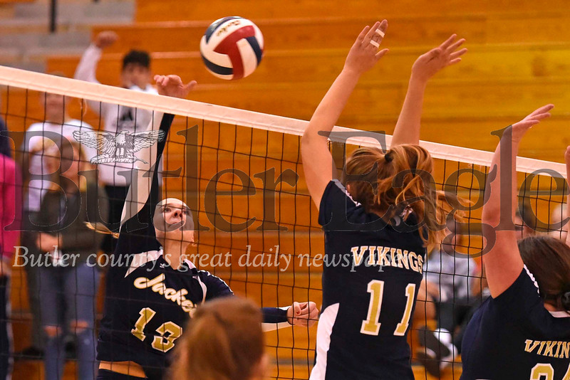 Freeport's Tori Radvan (13) hits over a Hopewell block attempt by Rachel Katekovich (14) and Kristen Kaminski (24). Seb Foltz/Butler Eagle