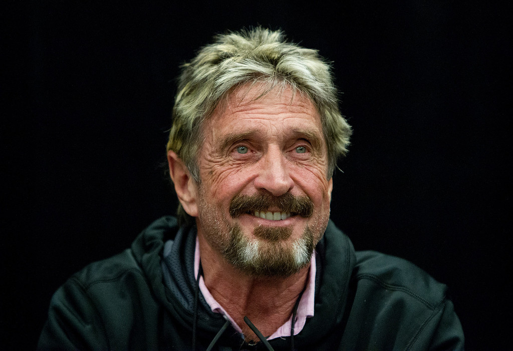 """. John McAfee reacts to a question at the \""""Fireside Chat with John McAfee\"""" talk during the C2SV Technology Conference + Music Festival at the McEnery Convention Center in San Jose, Calif., on Saturday, Sept. 28, 2013.   (LiPo Ching/Bay Area News Group)"""