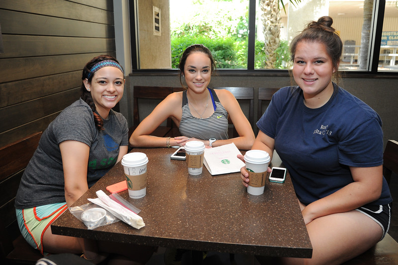 Students Anastasia Perez, Allyson Sturgem and Sydney Hams smile at our camera during their break.