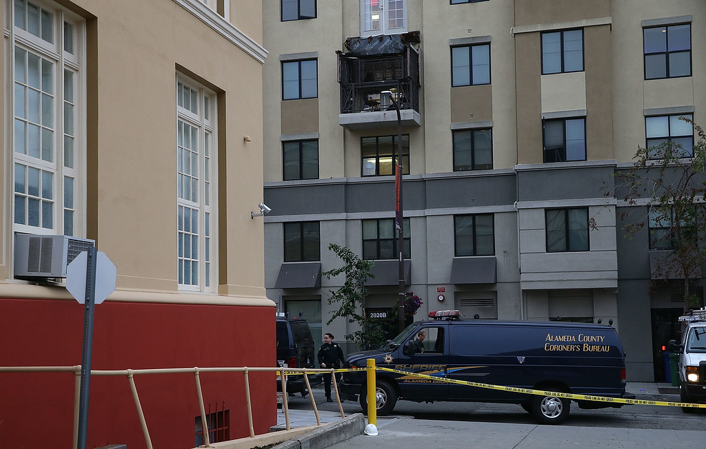 . A coroner vehicle sits parked at the scene of a balcony collapse at an apartment building near UC Berkeley on June 16, 2015 in Berkeley, California. Six people were killed and seven were seriously injured when a balcony collapsed at an apartment building near the University of California at Berkeley campus.  (Photo by Justin Sullivan/Getty Images)