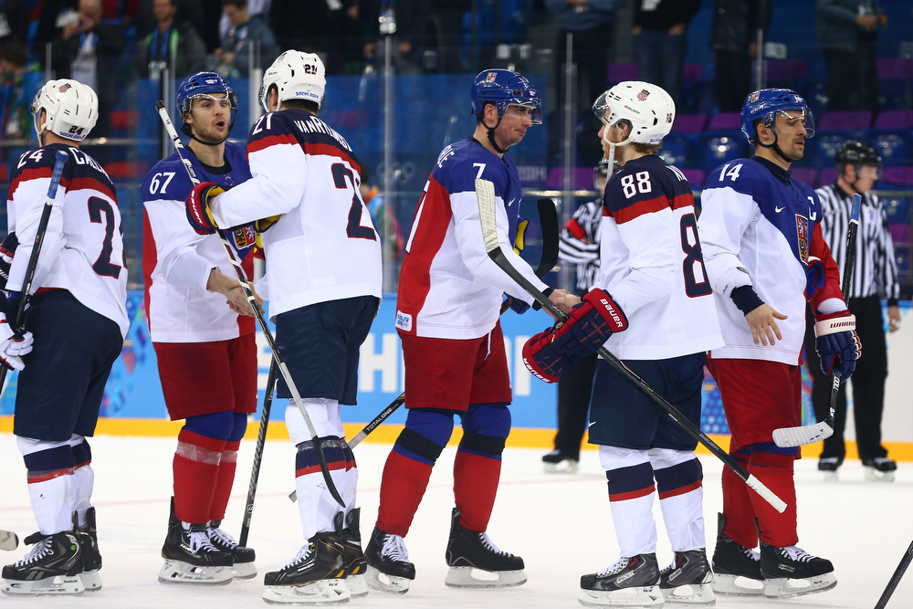 . Opposing players shake hands following the Men\'s Ice Hockey Quarterfinal Playoff between the United States and the Czech Republic on Day 12 of the 2014 Sochi Winter Olympics at Shayba Arena on February 19, 2014 in Sochi, Russia.  (Photo by Clive Mason/Getty Images)