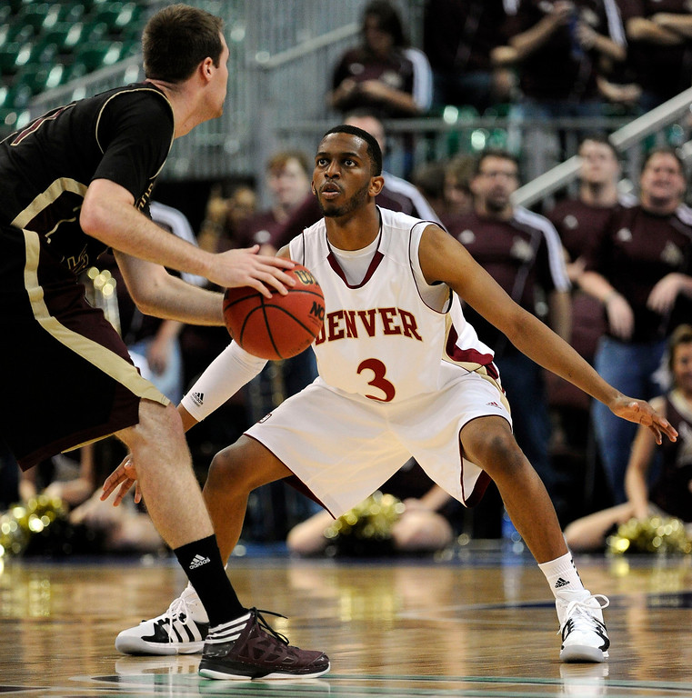 . Denver\'s Jalen Love (3) guards against Texas State\'s Matt Staff during the second half of a Western Athletic Conference tournament NCAA college basketball game on Thursday, March 14, 2013, in Las Vegas. Texas State won 72-68. (AP Photo/David Becker)