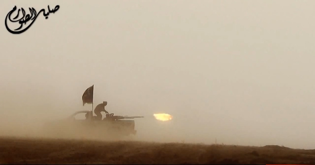 . An image grab taken from a propaganda video uploaded on June 8, 2014, by the jihadist group the Islamic State of Iraq and the Levant (ISIL) allegedly shows ISIL militants firing from the back of a vehicle near the central Iraqi city of Tikrit. Militants battled Iraqi security forces in Tikrit on June 11, 2014, after jihadists seized a swathe of the north, including second city Mosul, officials said. Heavy clashes rocked the north of Tikrit, hometown of now executed dictator Saddam Hussein, a provincial councillor said. AFP PHOTO / HO / ISIL (AFP/Getty Images)