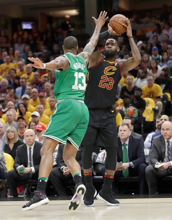. Cleveland Cavaliers\' LeBron James (23) shoots against Boston Celtics\' Marcus Morris (13) in the first half of Game 3 of the NBA basketball Eastern Conference finals, Saturday, May 19, 2018, in Cleveland. (AP Photo/Tony Dejak)