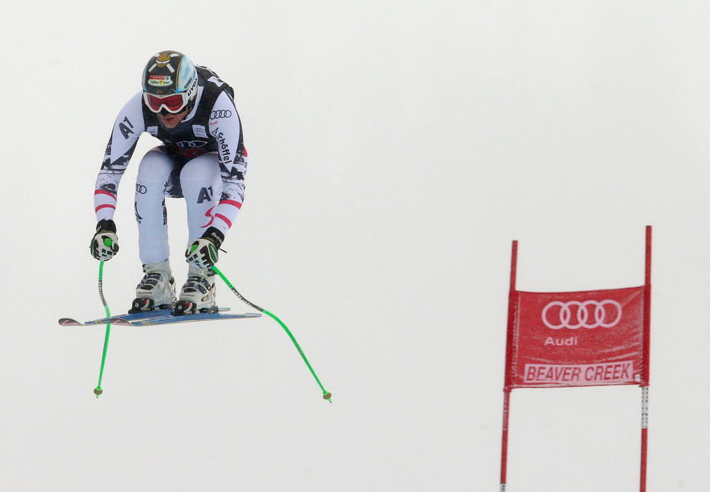 . Austria\'s Hannes Reichelt flies off the last jump during the men\'s World Cup downhill skiing event, Friday, Dec. 6, 2013, in Beaver Creek, Colo. Reichelt posted the second fastest time behind Norway\'s Aksel Lund Svindal.  (AP Photo/Charles Krupa)